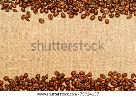 coffee grains on the burlap backgruond with copy space - stock photo