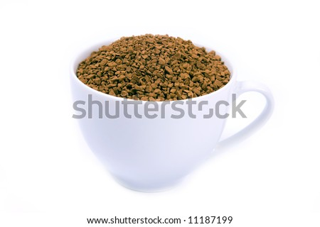 Coffee granules in a white cup isolated.