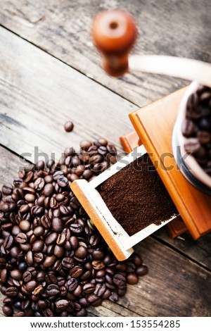Coffee grinder and coffee beans. - stock photo