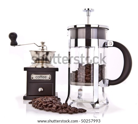 coffee grinder and coffee beans with cafetiere
