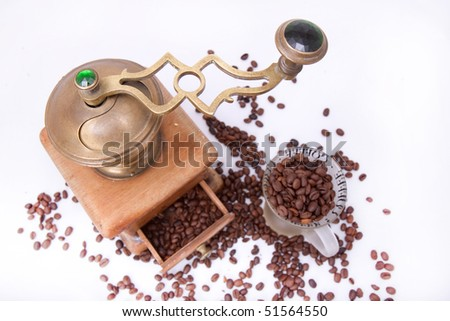 coffee grinder and cup with coffee beans