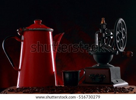 Coffee grinder and old red jug for coffee