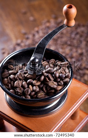 Coffee grinder with coffee beans - stock photo