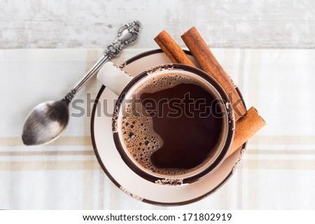 Coffee / Hot chocolate with cinnamon stick - stock photo
