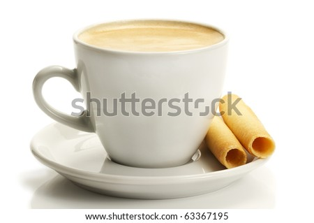 coffee in a white cup with rolled cookies or piroulines on white background - stock photo