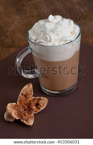 Coffee in glass cup with whipped cream - stock photo