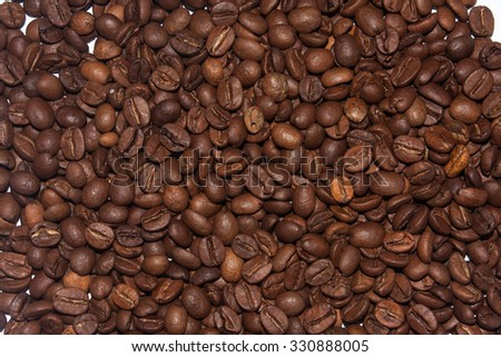 Coffee in grains as background.