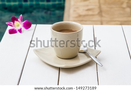 Coffee in Grey Cup on white wood table - stock photo