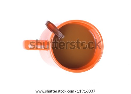 Coffee in orange cup with spoon