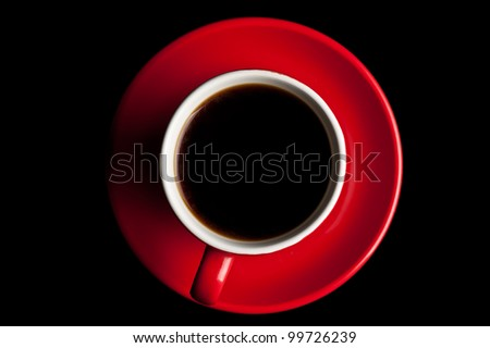 Coffee in red cup on black background