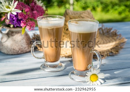 Coffee in the sunny summer garden - stock photo