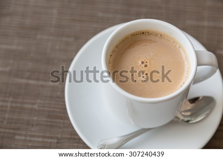 Coffee in white cup - stock photo