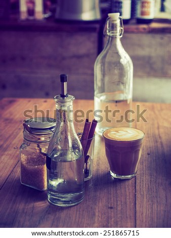 coffee latte art in coffee shop vintage color - stock photo