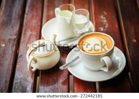 coffee latte art on the wood desk at coffee shop - stock photo