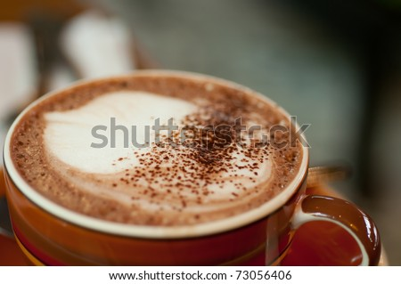 Coffee Latte in a red cup - stock photo