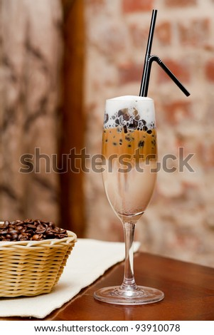 Coffee  latte macchiato with coffee beans in basket - stock photo
