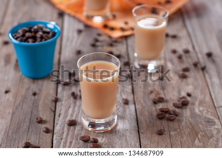 Coffee liqueur on the wooden table, selective focus - stock photo