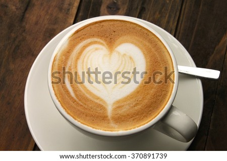 Coffee Love, heart shaped coffee in white cup and saucer - stock photo