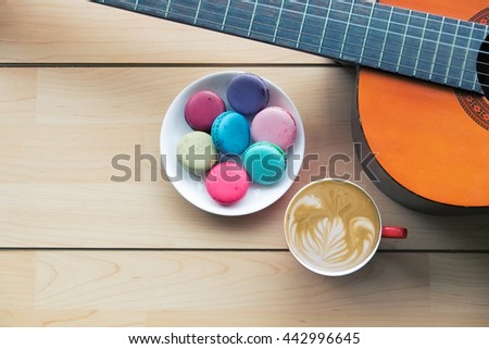 Coffee, macaroons and guitar for a relax time. - stock photo