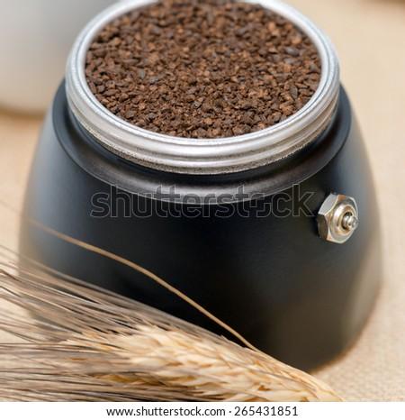 Coffee machine filter with ground barley - stock photo