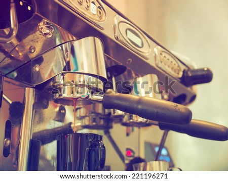 coffee machine in vintage color tone - stock photo