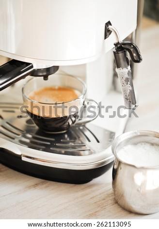 coffee machine makes coffee - stock photo