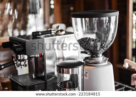 Coffee maker and coffee grinder  in coffee shop - stock photo