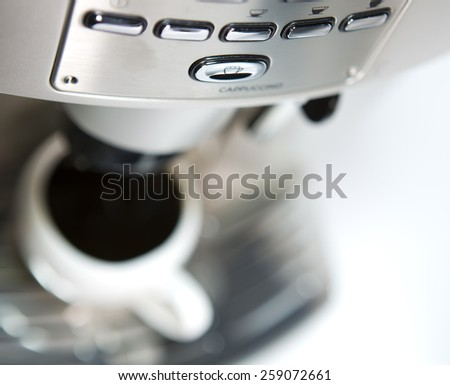 coffee maker and cup, small depth of sharpness - stock photo