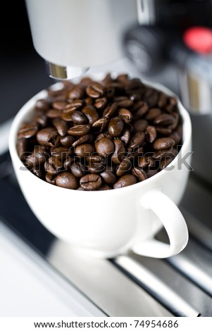 Coffee maker and cup with beans