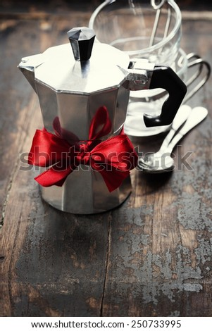 Coffee maker and cups on wooden background - stock photo