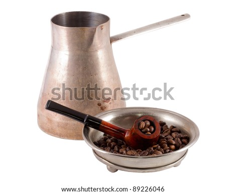 Coffee maker and pipe with coffee beans - stock photo