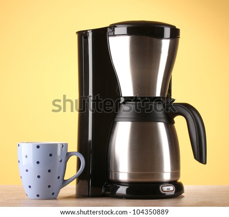 Coffee maker on yellow background