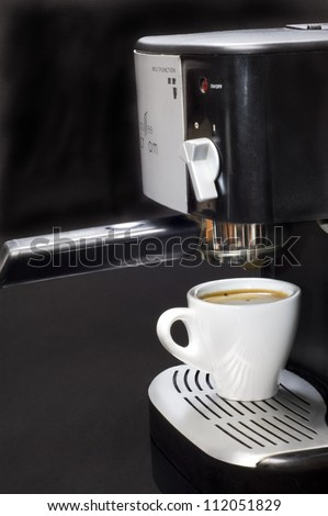 Coffee maker with coffee cup - stock photo