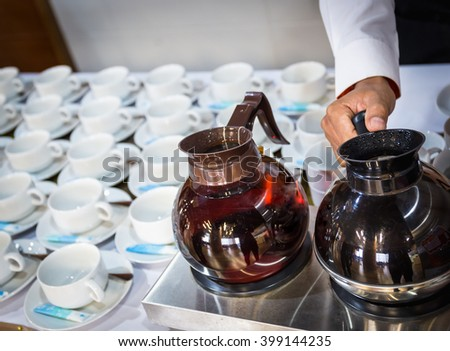 coffee maker with man hand and Many rows of white cup - stock photo