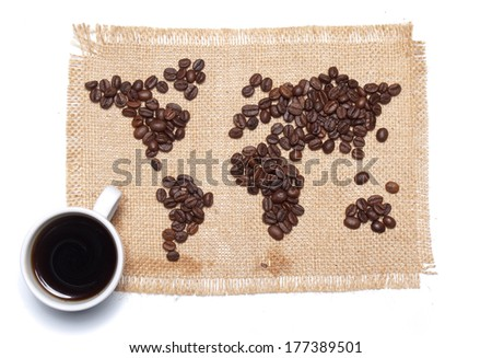 Coffee map on hessian background with white cup - stock photo