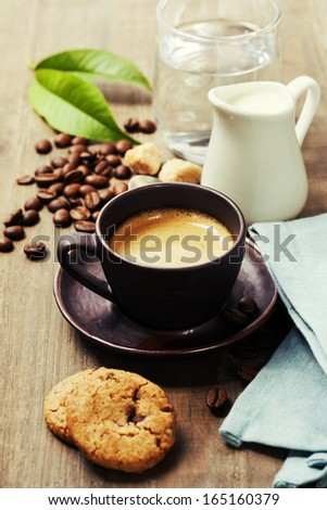 Coffee, milk and cookies on wooden background - stock photo