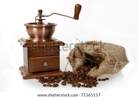 coffee mill with burlap sack of roasted beans