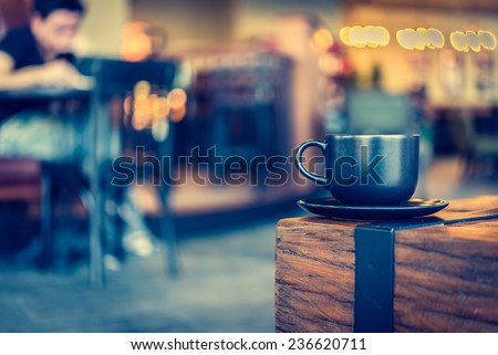 Coffee mug in coffee shop cafe - Vintage effect style pictures - stock photo