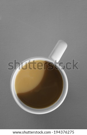 coffee mug with cappuccino on grey background. Mimimalistic studio shoot. Above view - stock photo