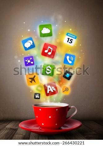 Coffee mug with colorful media icons, close up - stock photo