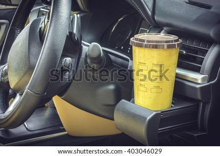 Coffee mugs yellow Placed on the vehicle console - stock photo