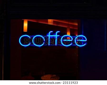 Coffee neon sign glowing blue - stock photo