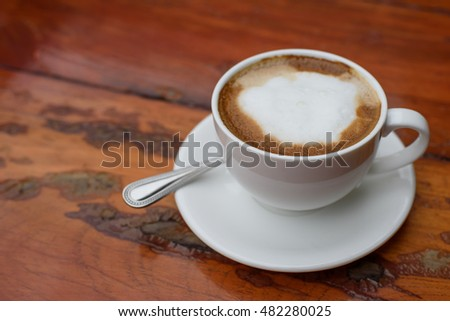 Coffee on a wood background