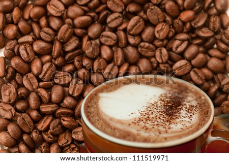 coffee on coffee bean - stock photo