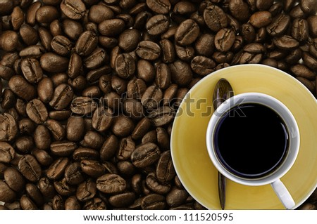 Coffee on coffee bean background - stock photo