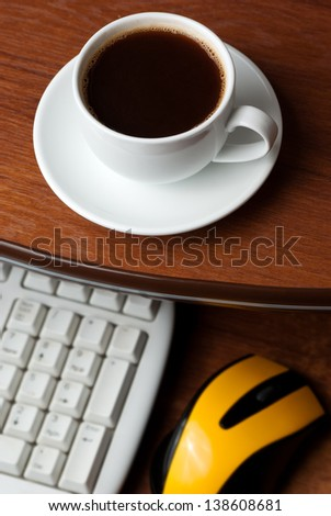 Coffee on computer desk. Keyboard and mouse - stock photo