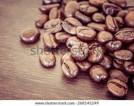 Coffee on grunge wooden background with filter effect retro vintage style - stock photo