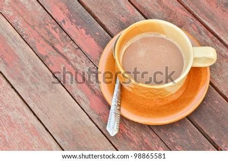 coffee on vintage wood table - stock photo