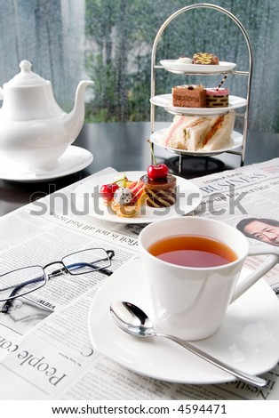 Coffee over newspaper - stock photo