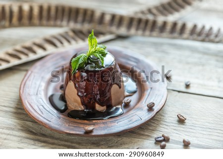 Coffee panna cotta under chocolate topping - stock photo